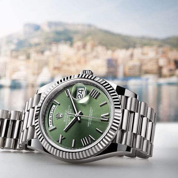 080eacdb842 The Day-Date 40 in 18ct white gold with an olive green dial features a  weekday display that is available in 26 languages.  Rolex  DayDate  101031