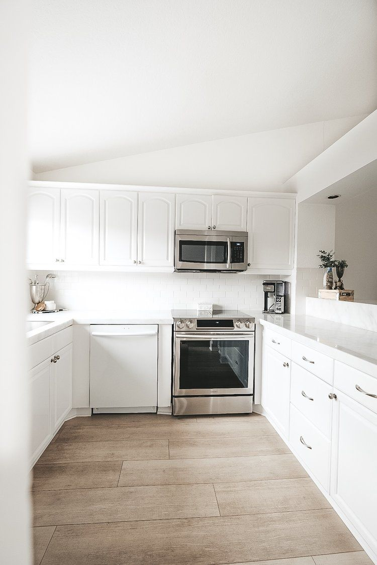 Pros And Cons Of Marble Counter Tops Me And Mr Jones Marble Countertops Kitchen Wood Floor Kitchen Light Wood Cabinets