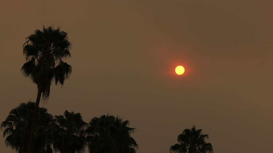 Raging 'Sand Fire' casts apocalyptic glow over Los AngelesThe morning sun over Pasadena Calif. is reduced to an orange disk by smoke from a wildfire burning north of Los Angeles on Saturday July 23 2016.  Image: AP Photo/John Antczak  By Keith Wagstaff2016-07-24 17:54:02 UTC  A blood red sun blazing through a massive ominous cloud of smoke hung above Los Angeles on Saturday as ash rained down below.  No it wasnt a sign of the apocalypse. It was the result of the Sand Fire that has consumed…