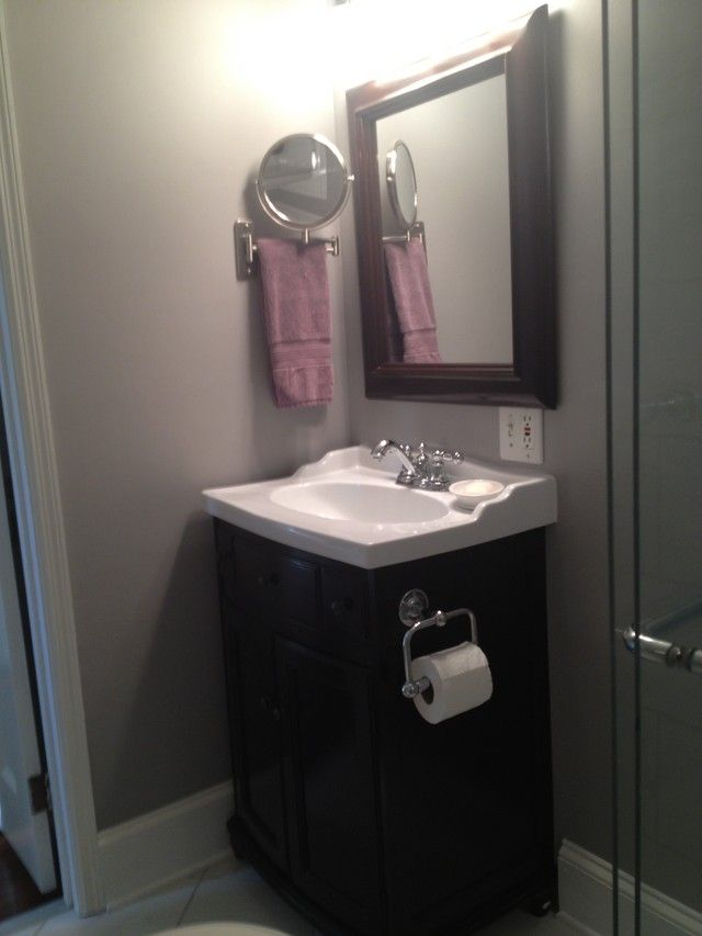 Toilet paper holder on side of vanity--Tiny Bathroom