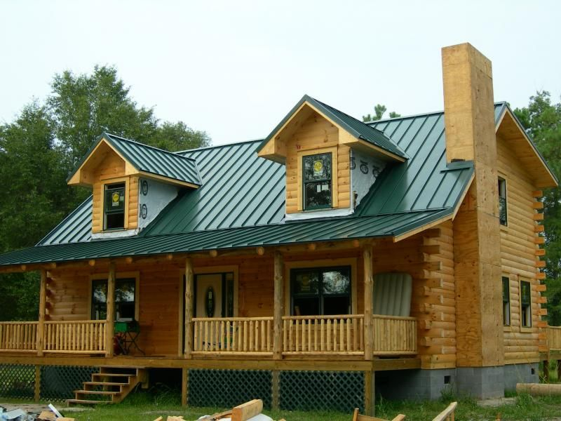 Green metal roof house paint colors i like pinterest for Cabin exterior paint colors
