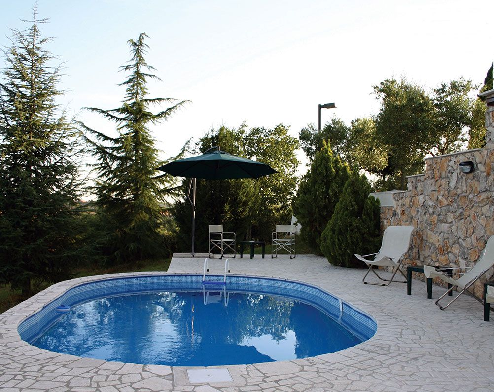 Piscina desmontable gre enterrada con exteriores de for Piscinas desmontables gre