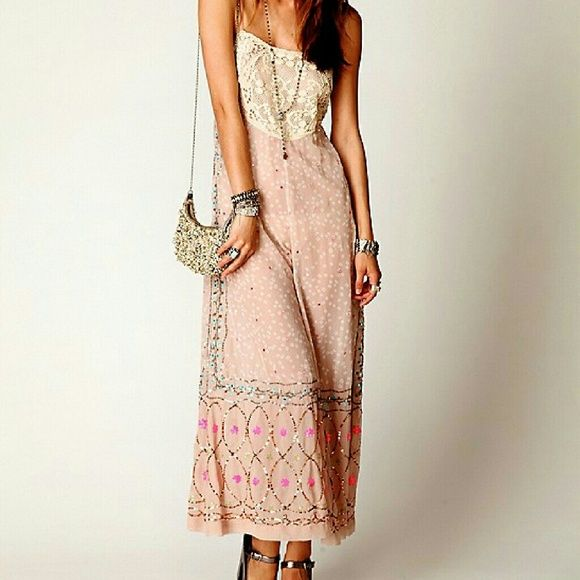 Free People New Romantics Embellished Jumpsuip XS Free People New Romantics embellished jumpsuit size XS (would fit S too). Retails for $298.  Ethereal sheer fabric, lace bodice and beads on bottom. One of a kind.  This is new. It comes with little bag with extra beading atached.  *** I will trade only for following items***  Dr Martens Jadon or Clemency red Matte on 4uk. Dr Martens GRETCHEN 4 uk Lazy Oaf Flower Power dress Lazy Oaf so broke jacket. Free People Dresses Maxi