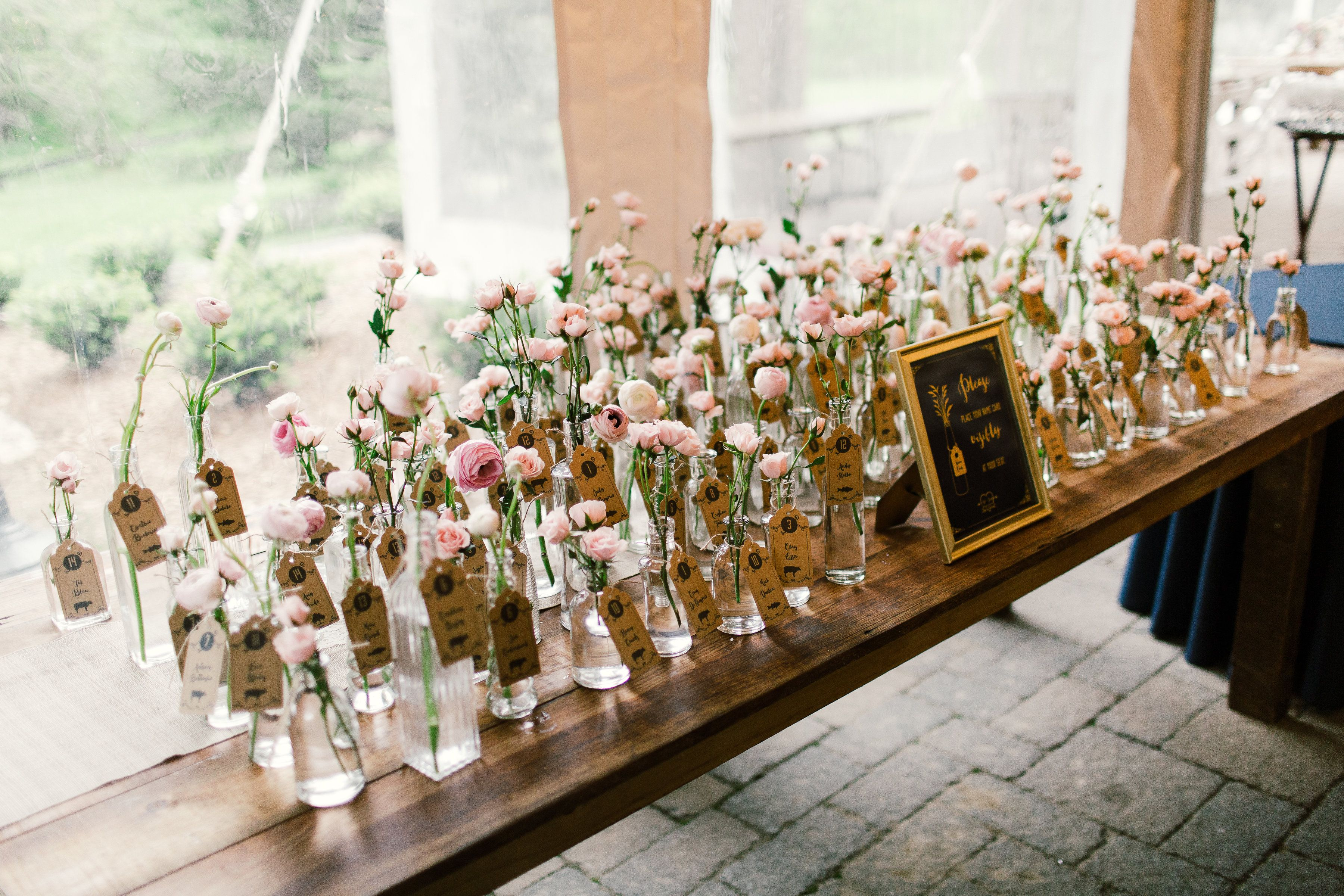 Sprigs of pink spray roses and ranunculus fill the collection of
