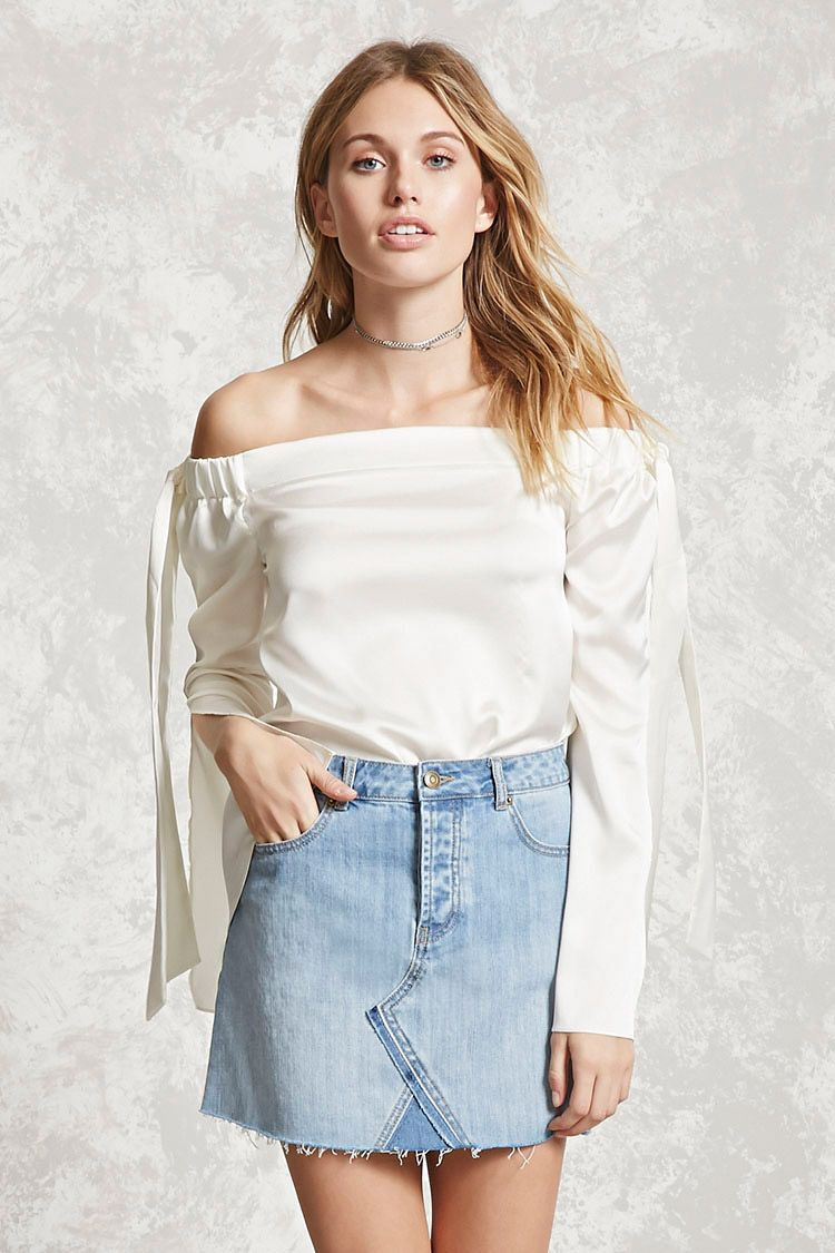 Forever 21 Contemporary - A denim skirt featuring colorblock trim and asymmetrical seam-stitched panels on the front, raw-cut hem, a five-pocket construction, and a zip fly.