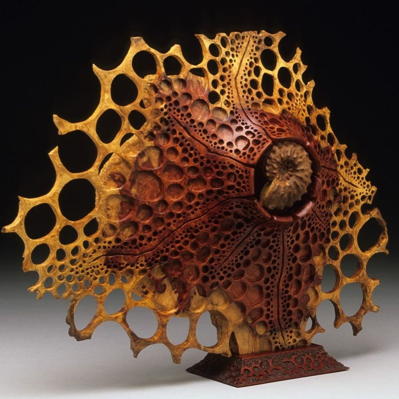 """Ammonite"" 13""h x 15""w x 3""d. Amboyna Burl; African Padauk stand. George Post, photography."