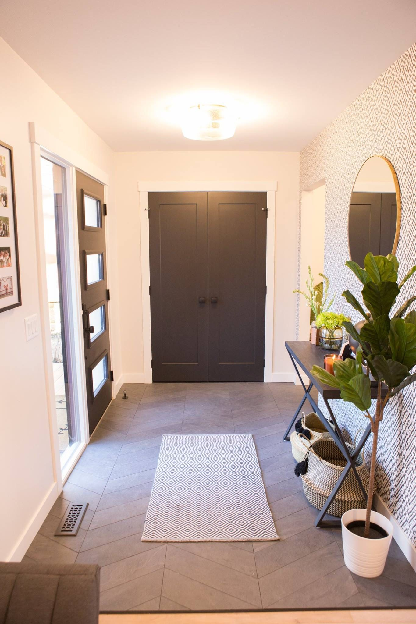 Oversized entry way with modern Herringbone tile and light