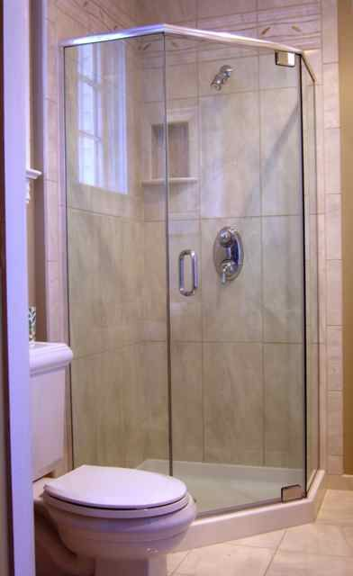 Frameless shower enclosure with header, prefab base and tile walls ...