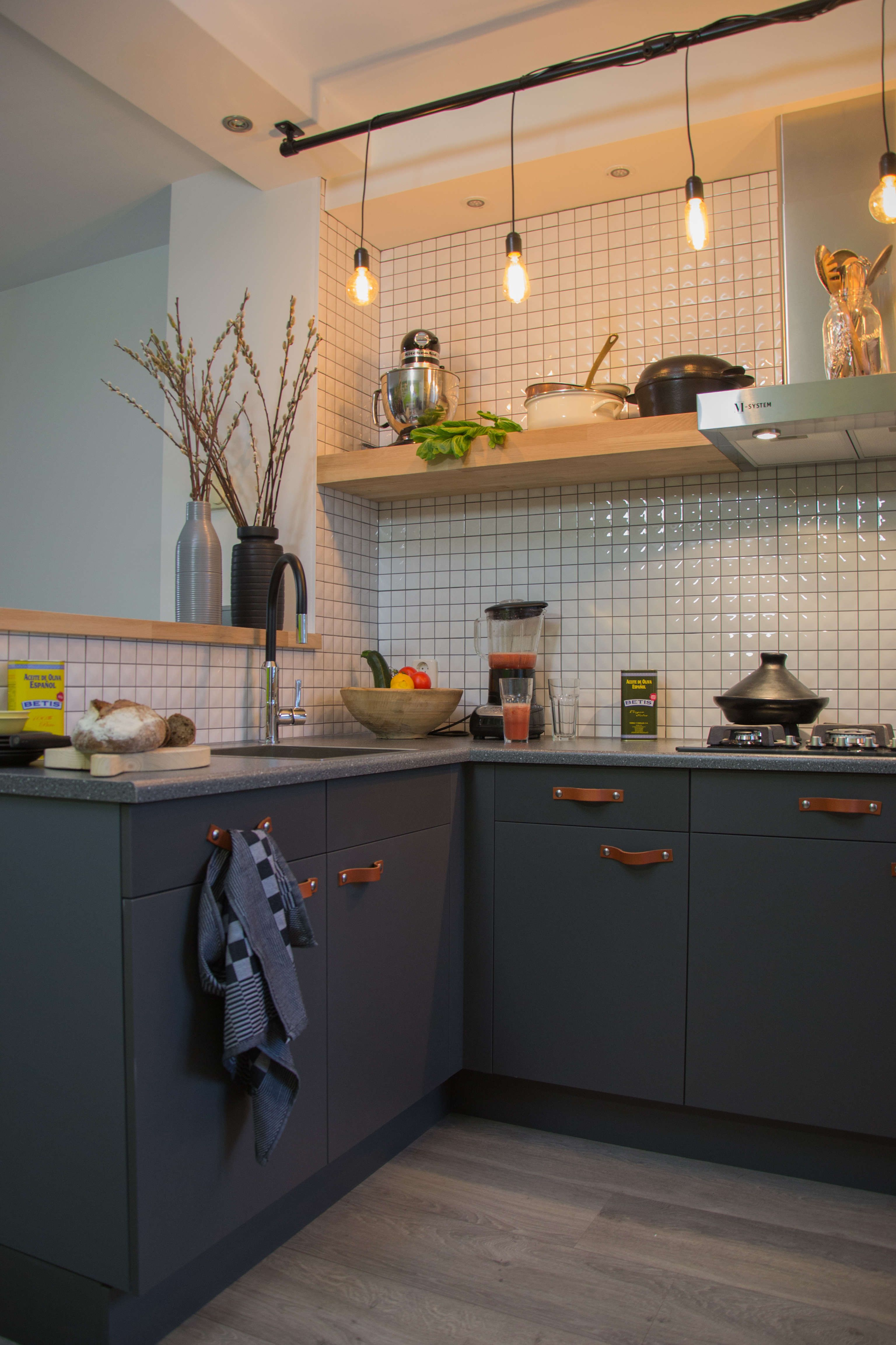 I like the way the tile back splash reflects the light. The leather ...