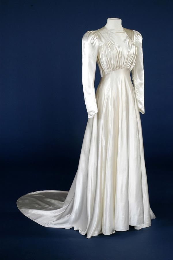 Wedding dress of ivory rayon satin with square neckline. English ...