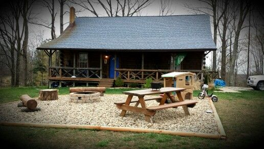 Large river rock patio with fire pit, picnic table and ...