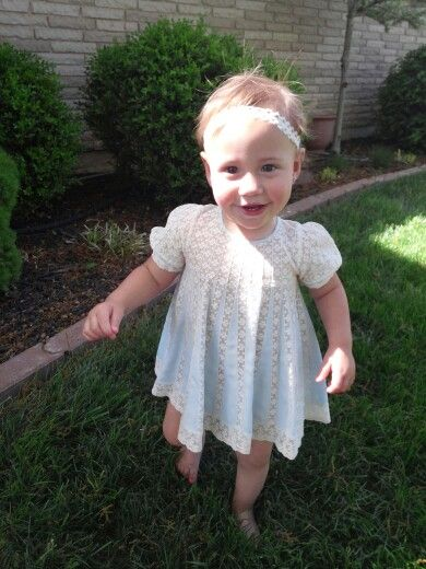she's wearing the dress made by her great-great Grandmother