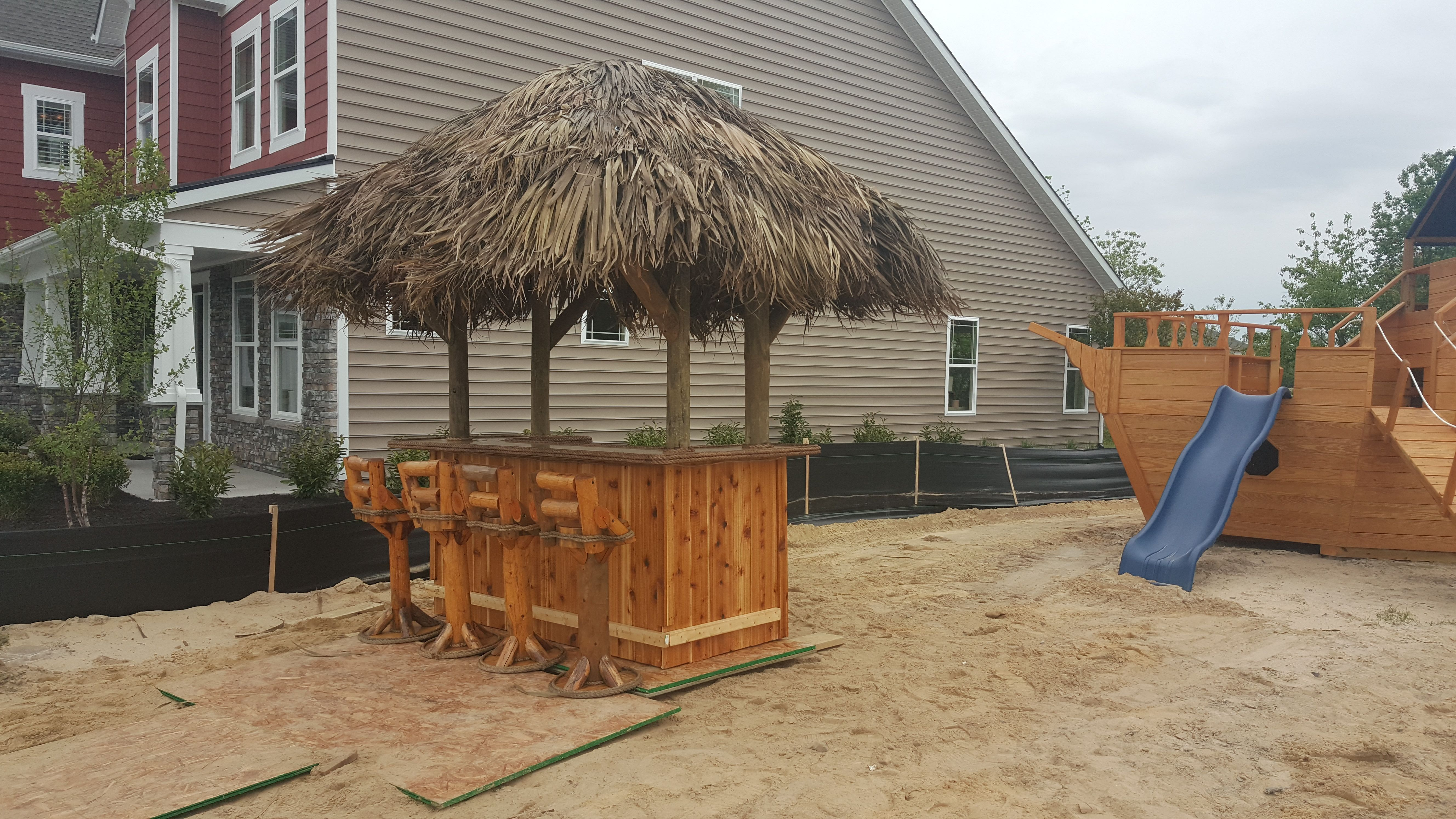 4 x 8 Tiki Bar with a 5 x 9 cedar framed thatched roof with