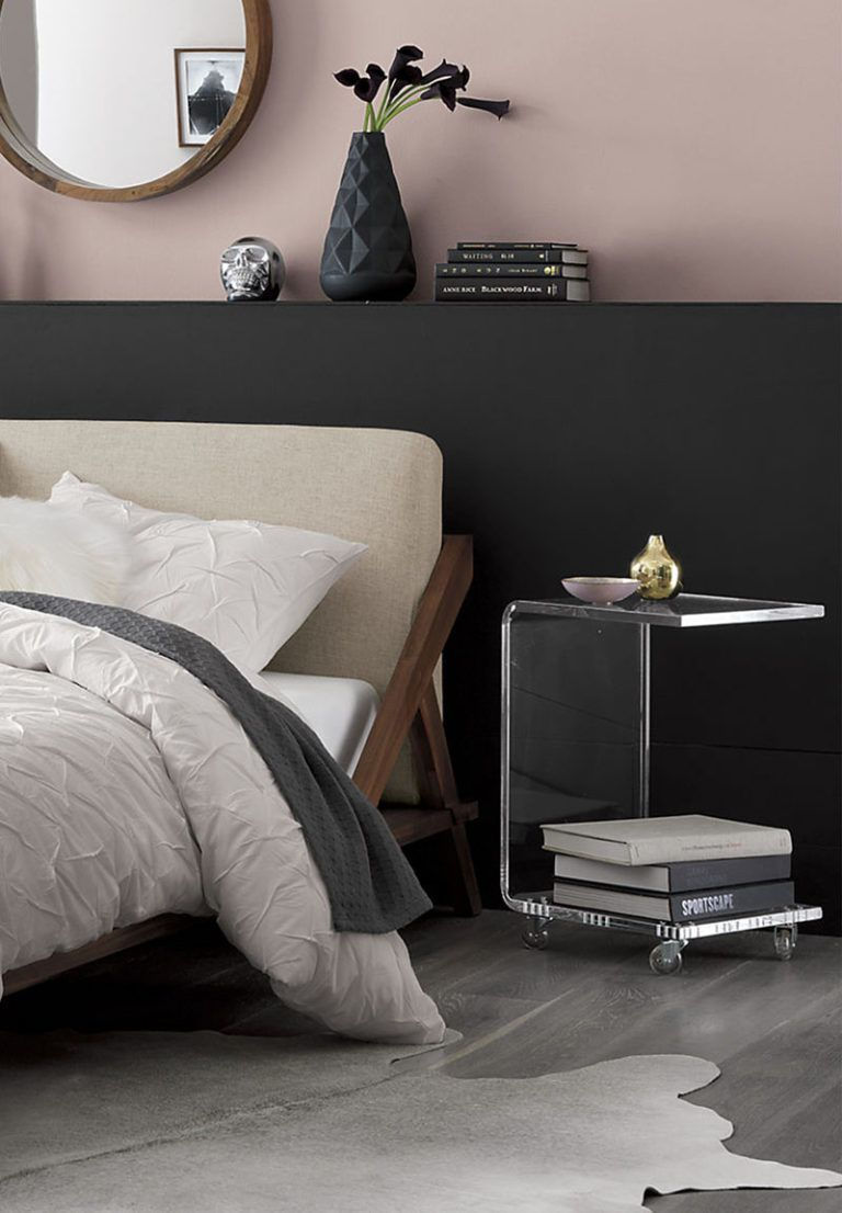 5 Ways To Use Acrylic Decor Throughout Your House // Bedroom - This C-shaped acrylic bedside table lets tons of light through and is on wheels to make it easy to move around the room.