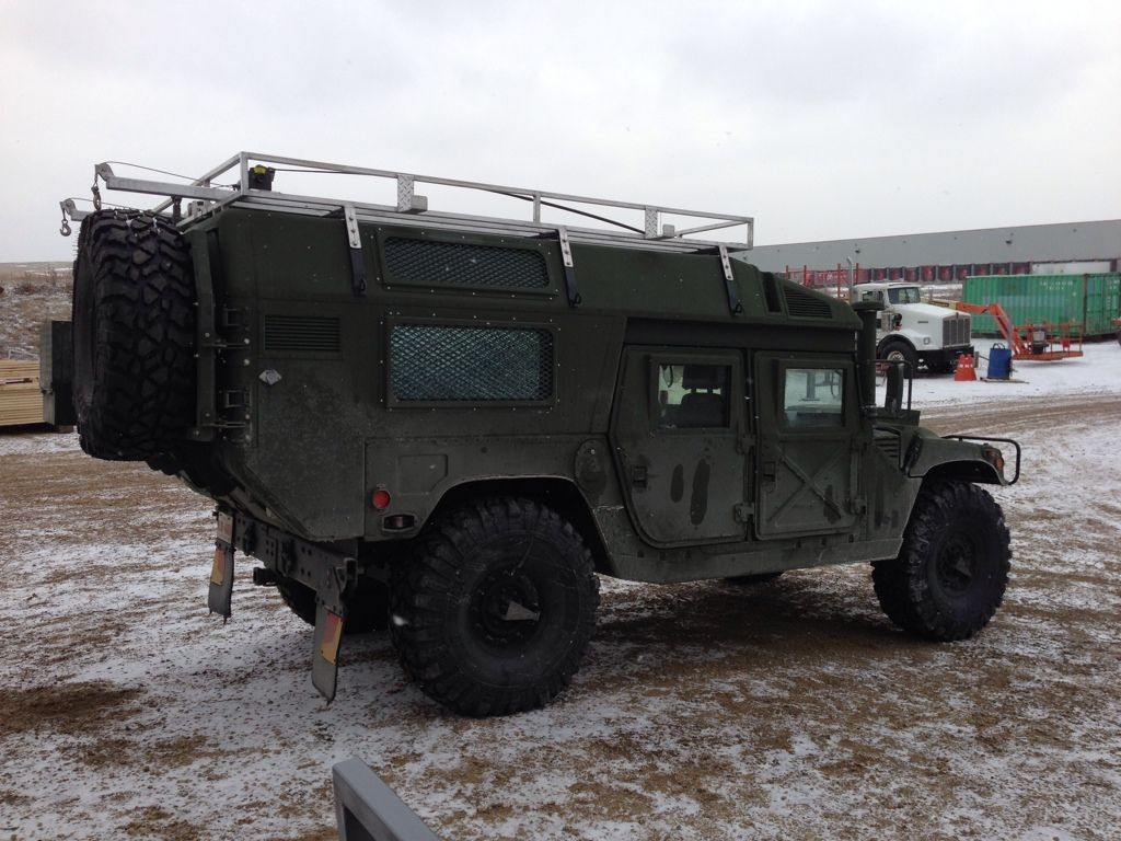 Modified civilian hummer h1 looks like a humvee after being fitted with a surplus military ambulance