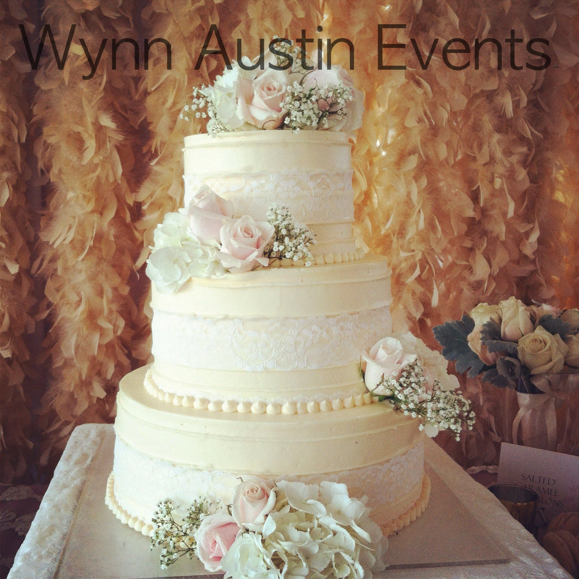 Cake with blush and peach feather backdrop wynn austin events
