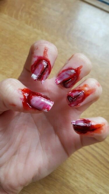Halloween nails SFX  Perfect if your on a budget and cant afford a full costume or that added extra to an existing costume. All you need is some red and black nail varnish, fake nails and nail glue and for extra gore factor some fake blood :)