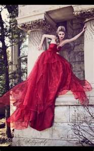 Model, Laura Kirkpatrick, rocks this red evening gown set on an old world architechtural background.