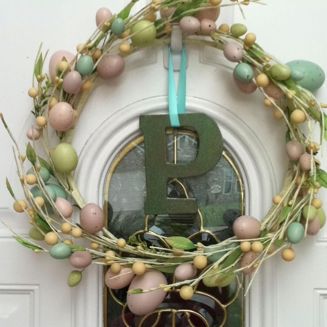 Easter Wreath! Super easy! Got the wreath from Michaels on sale for $6.50. Then spray painted my wooden 'P' a tan color, let it dry for 15 minutes, then sealed it will a spray glitter. Hung the letter with satin ribbon by the door hook, so I can use it again for my next holiday door hanging!