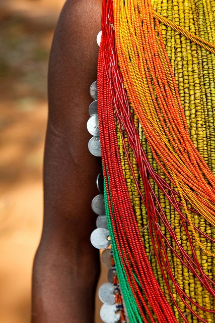 Details from the traditional dress of a tribal Bonda woman, at the weekly Thursday market held in Onkadelli