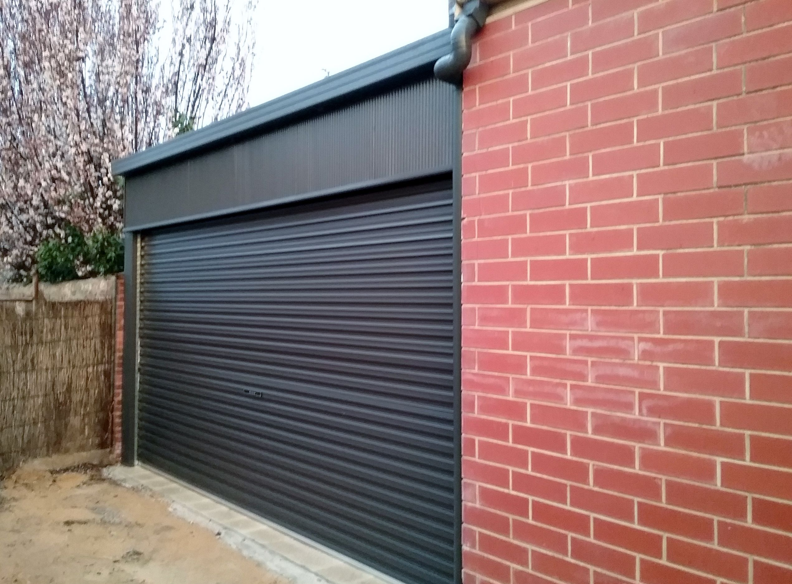 Double wide carports with roller door