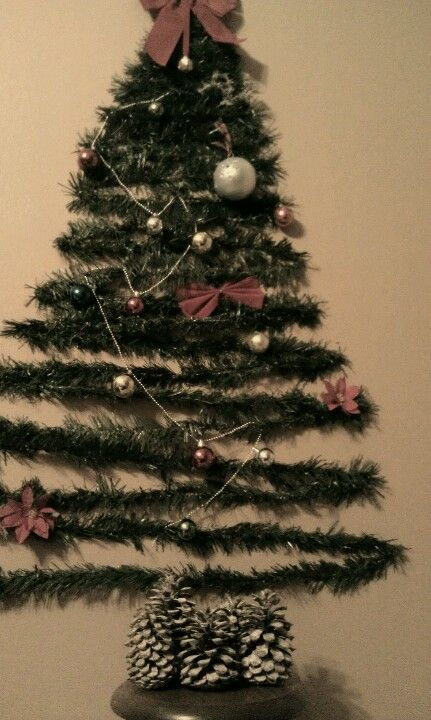 Trees too expensive? Don't have the room? Use garland or lights on the wall and bam instantly ...