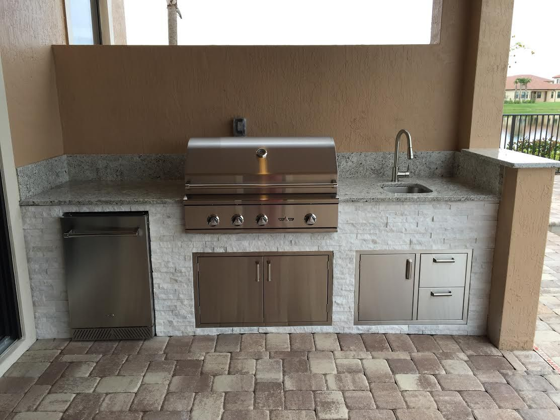 Fresh outdoor kitchen for wci communities featuring a for Outdoor kitchen refrigerators built in