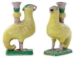 lighting, China, A pair of Chinese porcelain phoenix-form miniature candleholders, Qing Dynasty, molded scrolling design on standing birds supporting candle sockets, in yellow, green and aubergine glaze. Circa 1801-1900