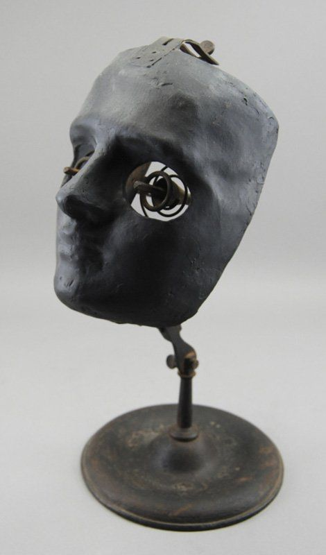"""""""Device used by ophthalmology students to hone surgical skills. Two spring mounted brass eyeholders with pincers would hold pig eyes for future ophthalmologists to practice their craft before operating on human patients""""    - Myers Fine Art"""
