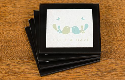 Lovingly designed, this set of coasters makes a wonderful gift for a loved-up couple, whether they're newlyweds or long-standing sweethearts.  How cute are these coasters?! Decorated with an oh-so-sweet pair of lovebirds, these glass coasters are the perfect surface to place a mug, wine glass, champagne flute – or just about any hot or cold beverage. Why not complete your set with a matching placemat set?