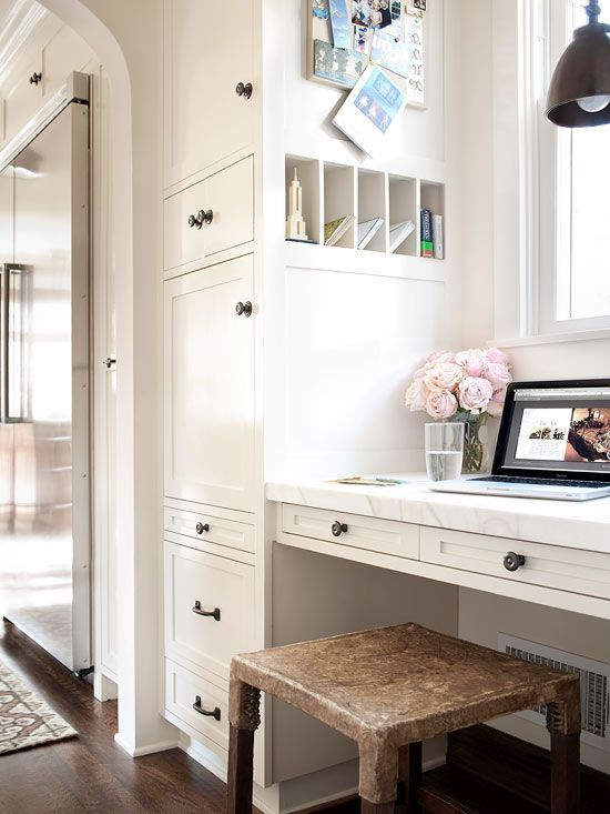 Having a home office or message center in the kitchen can be extremely helpful. However, without sufficient storage, the area can easily be overtaken by clutter. Here a floor-to-ceiling cabinet conceals a variety of office supplies and keeps everything organized and off the nearby kitchen counter. A five-cubby organizer built into side of the cabinets functions as a mini mailbox for each family member./