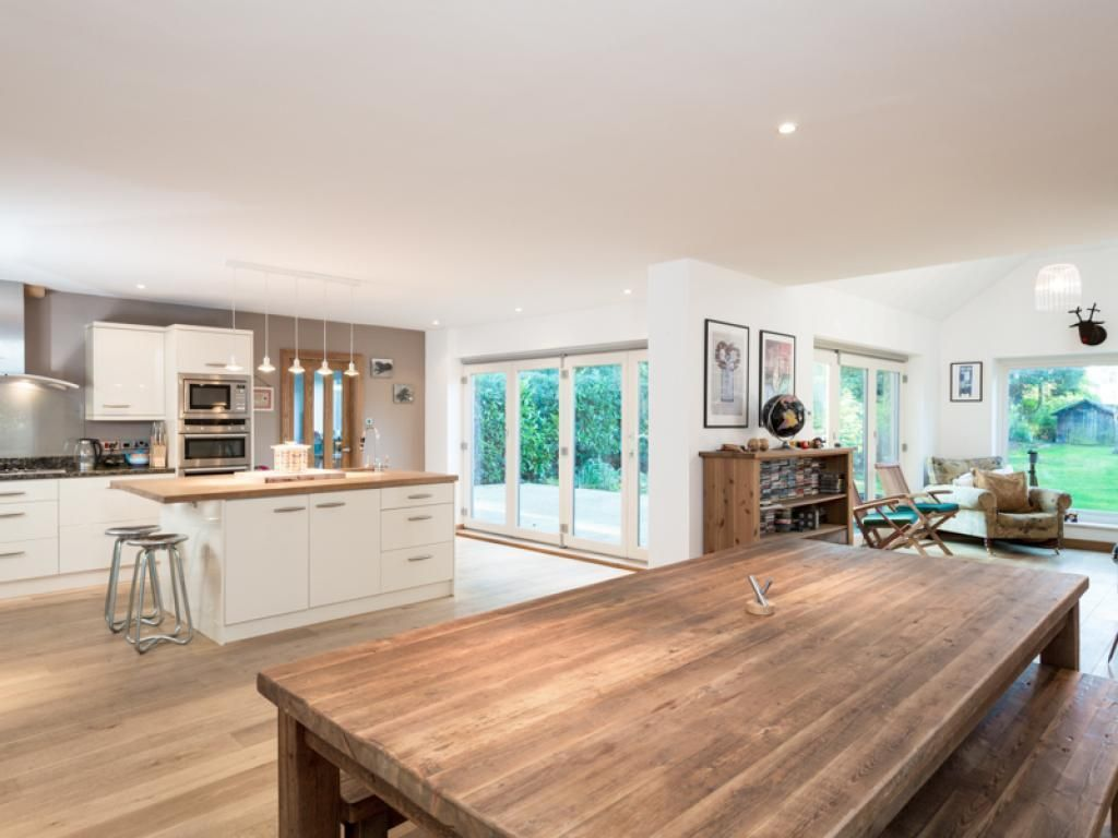 open plan kitchen dining room and living room area on timber