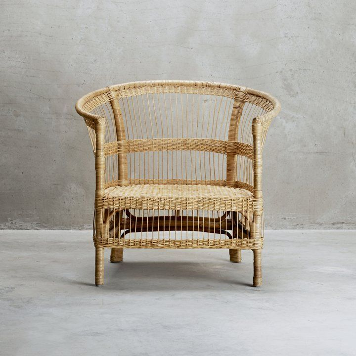 Armchair In Woven Rattan Which Is Both A Comfortable And Decorative Chair.  The Lounge Chair