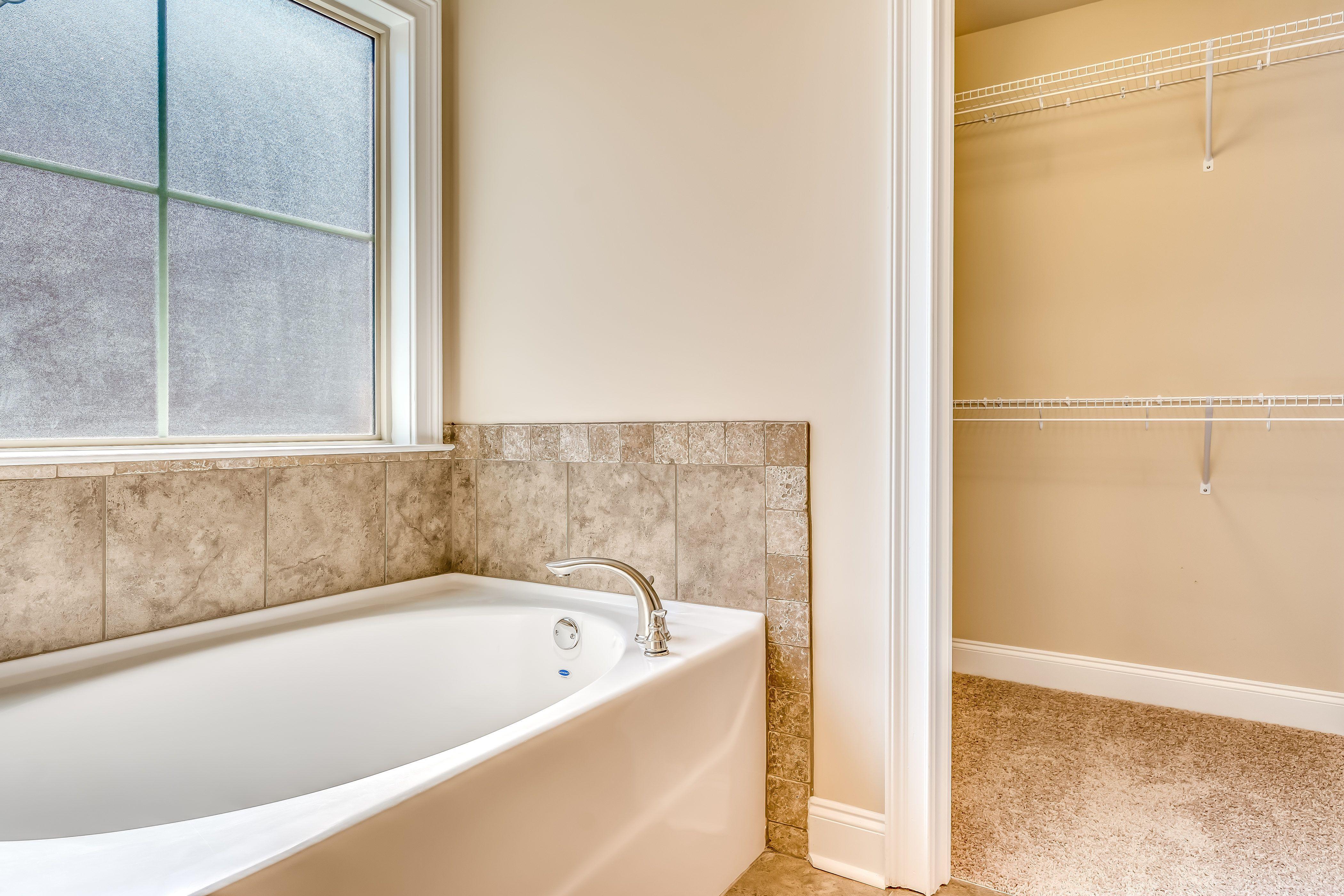Master bath garden tub and a peek into the master closet ...