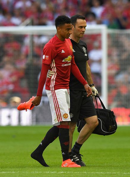 Jesse Lingard of Manchester United walks off the pitch with a member of the Manchester United medical staff during The FA Community Shield…