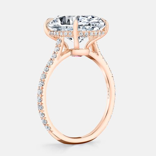 FRANCESCA is a custom solitaire engagement ring set in Rose Gold with a  rare D Color