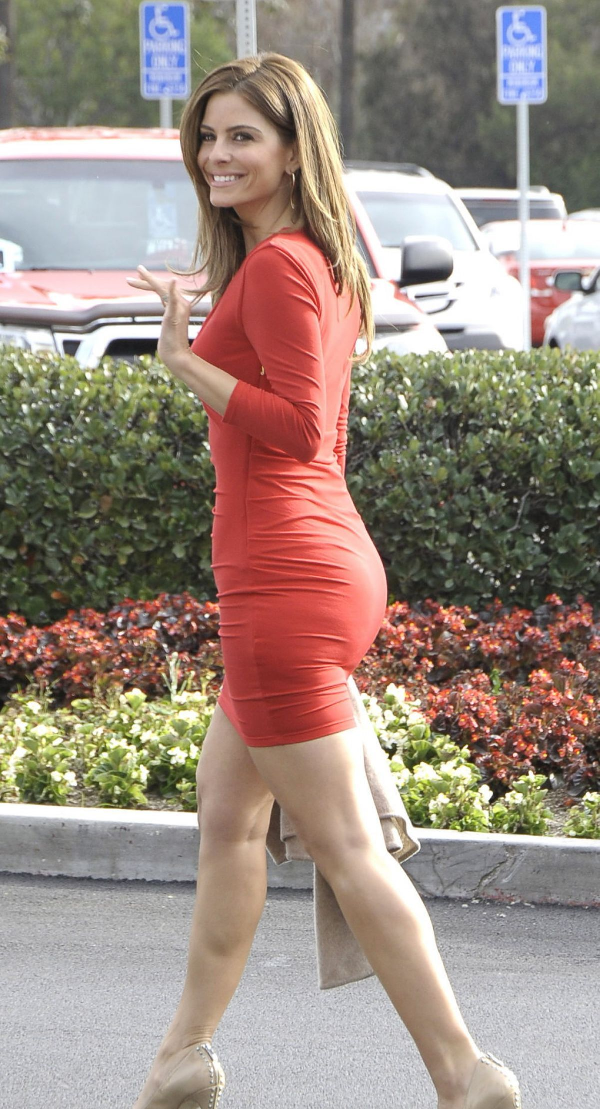 MARIA MENOUNOS in Tight Dress at Set of Extra in Los Angeles
