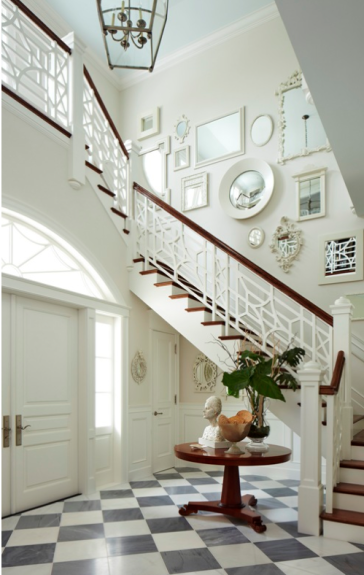 An arrangement of white painted frames