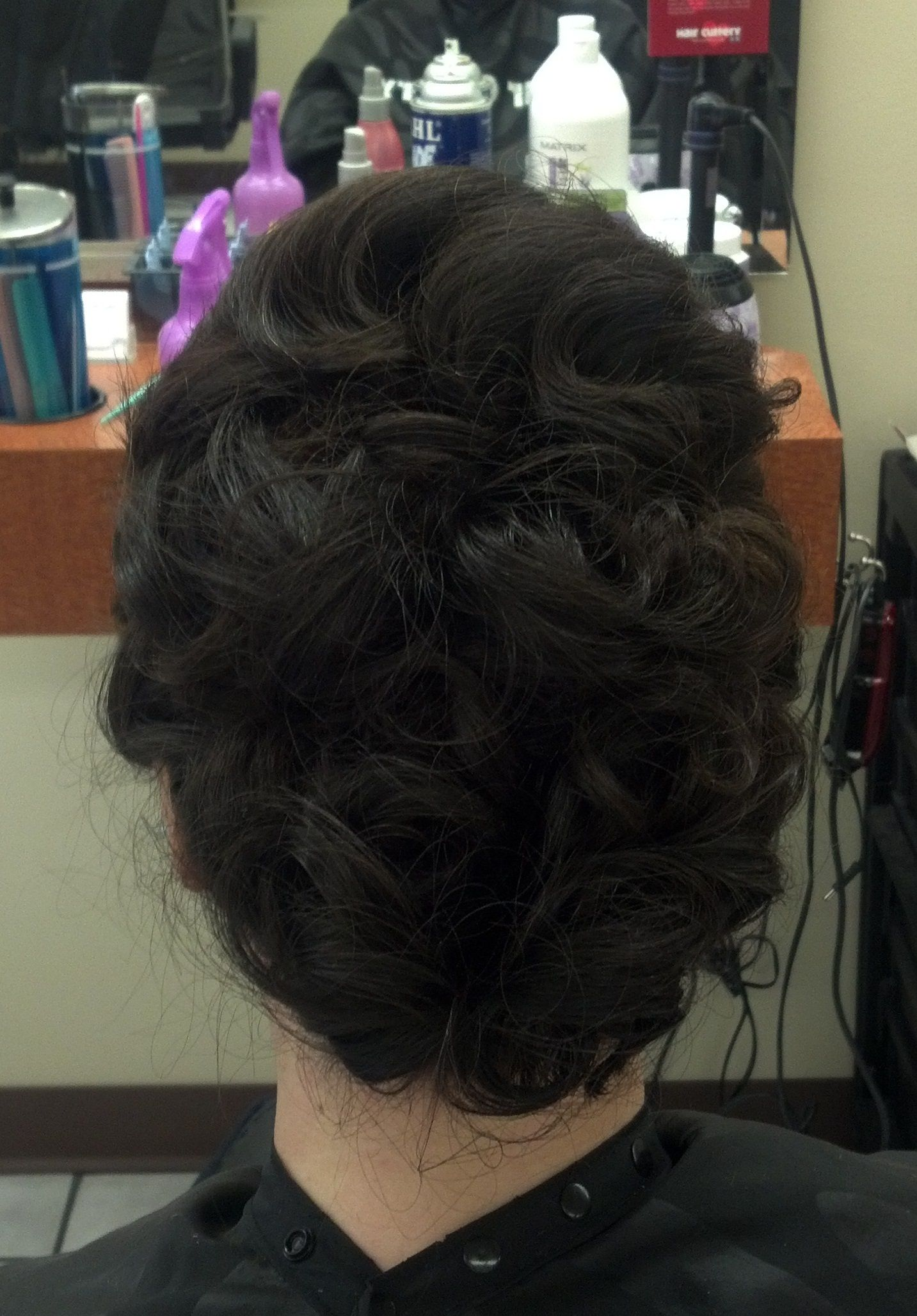 this is an updo i did for a lient going to the NIU black white and red ball