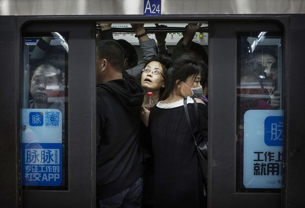 Photos of the Week: 10/11-10/17 - In Focus - The Atlantic - HA- This is no joke. I was in Hong Kong and rush hour in the tubes is the same. It's amazing how many people will get into the car ...