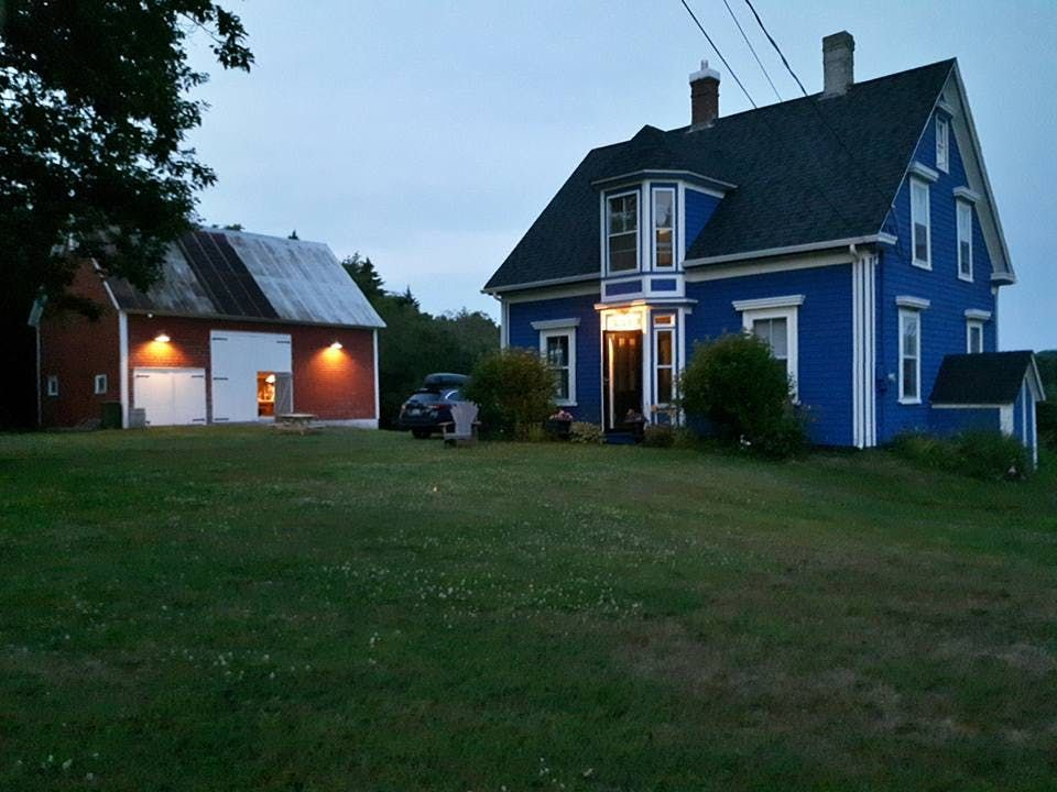 The rescue of a bright blue farmhouse barn in nova for Garage packages nova scotia