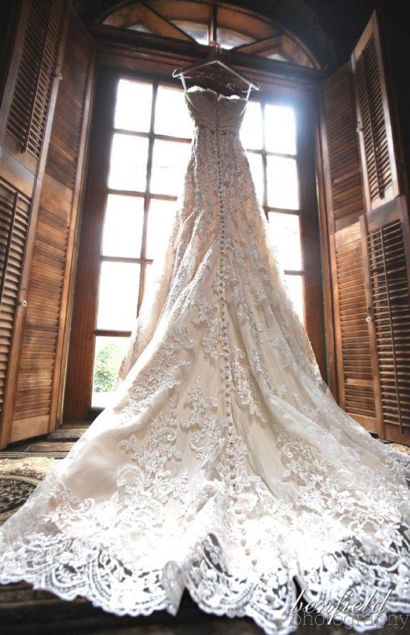 Beautiful Wedding Dress Hanging Up In The Window
