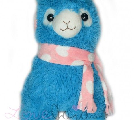 This is the neon blue alpaca plush with pink and white earmuffs from the Earmuff series of Arpakasso. It has a super adorable face and is really soft and cuddly! This is the biggest size available. This giant toy is sure to bring joy to whomever receives it!  This plush is approximately 50cm x 40cm large.