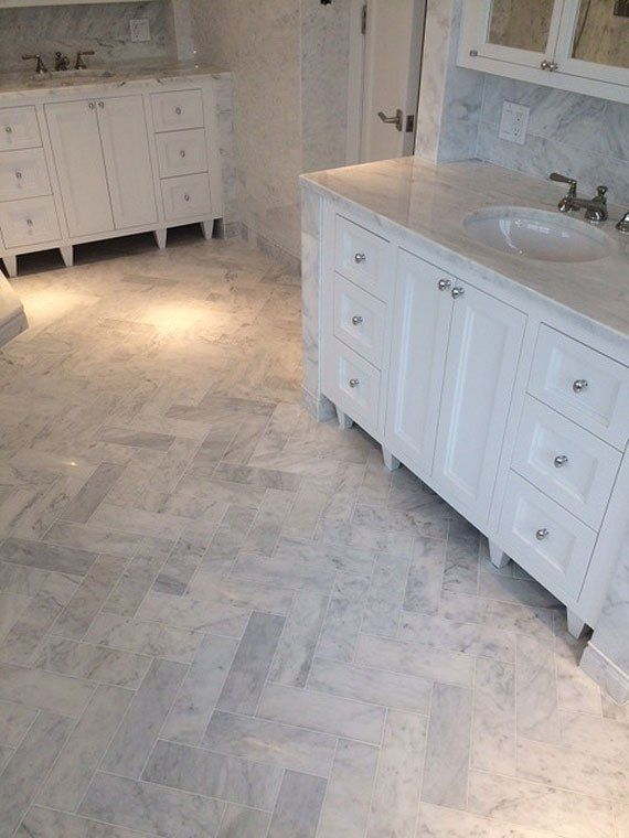 Living With Carrara Marble Carrara Marble Bathroom Herringbone Tile Bathroom White Bathroom Tiles