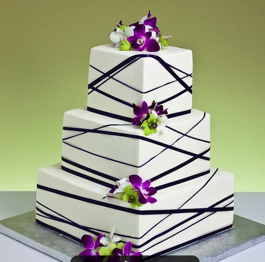 4 tier square wedding cake with diamond quilting and fresh flowers ...