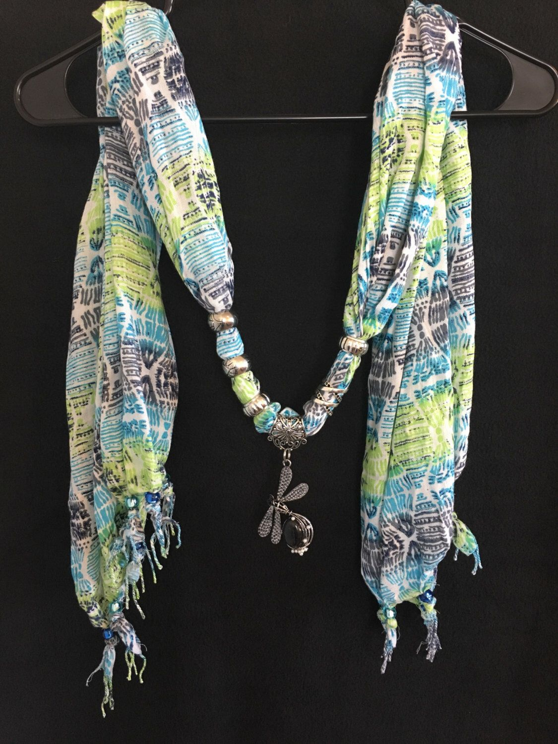 A personal favorite from my Etsy shop https://www.etsy.com/listing/487967844/dragonfly-energy-wrap-scarf-jewelry