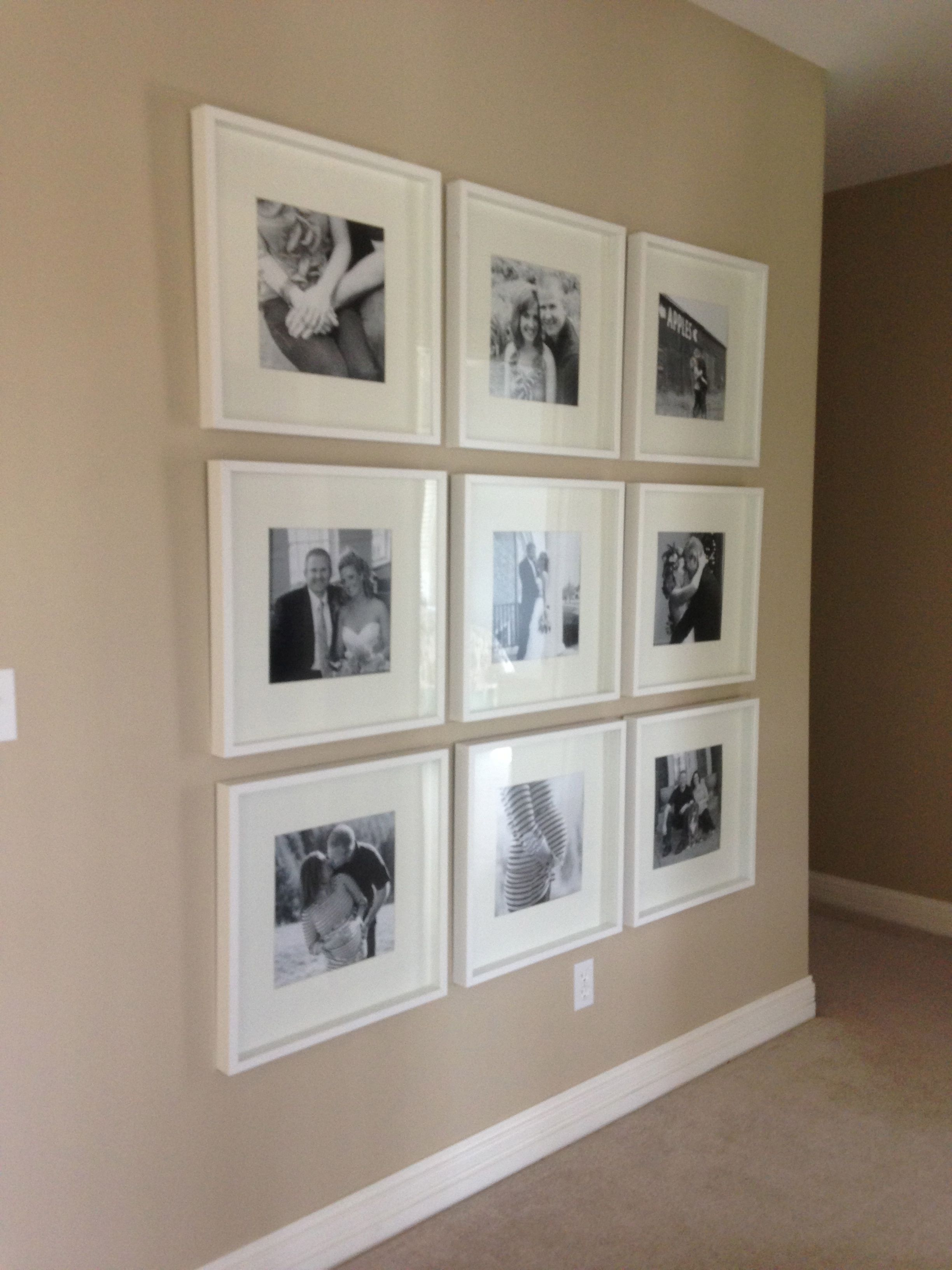 Black and white photo wall with Ikea frames