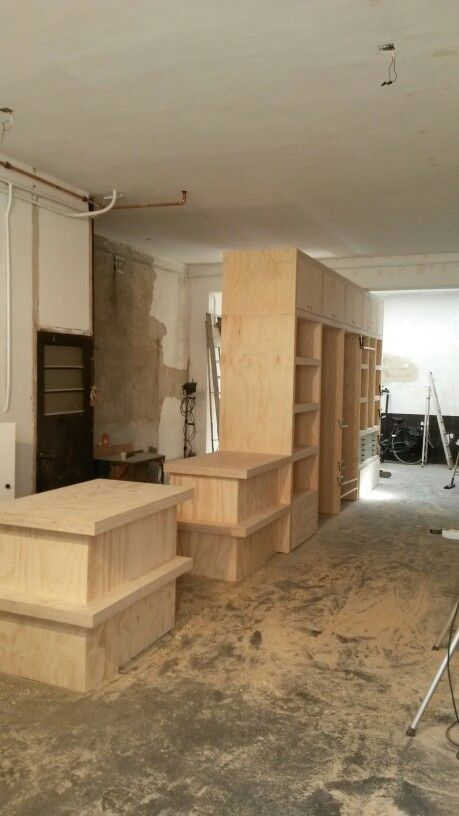 Shop interior made by houtlab. Underlayment Counters, changing rooms, shelving and storage.