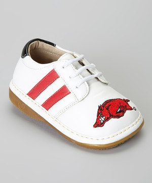 It's never too early to get into the spirit! Help little ones fly those colors with a sneaker that boasts the school logo and color-coordinated stripes! A squeaker sole means that Mom can hear where her little fan is at all times; but the squeak can be removed by an adult in just a few seconds.