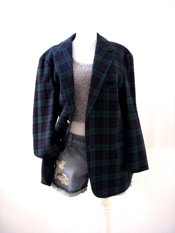 Mens wool jacket by Pendleton in a green, black and blue plaid. It is made of 100% wool; two button closure; back vent; partially lined; two flap